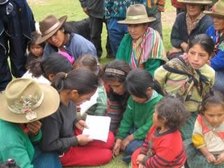 Peruvian indigenous people, learning to read. ...